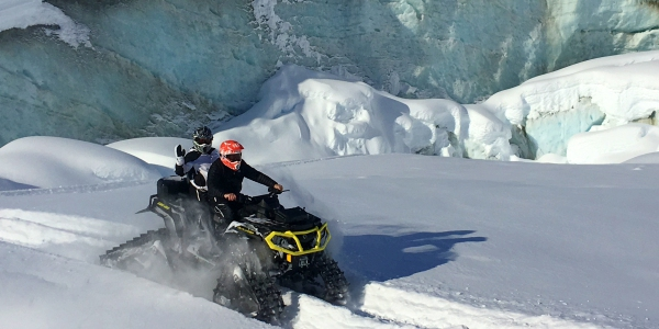 SnowBuggy Ice Cap Exploration as part of the Heli Ice Cave Explore. Photo by Paul Carus.
